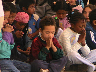 Children praying -Where two or more are praying in My name, so am I there with them.